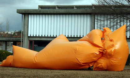 Big Blob inflatable suit slides along the ground in Nagoya, Japan