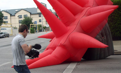 Mark Walley chases with camera in hand after an inflatable suit made by Jimmy Kuehnle.