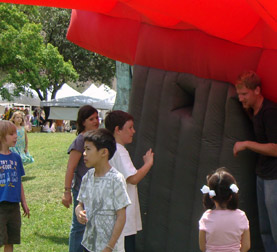James Kuehnle shows children how an inflatable suit works.