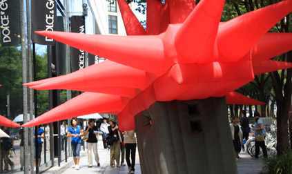 Big Red inflatable suit careening down Japanese Sidewalk.