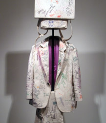Detail of a hand-made canvas suit with marker grafitti
