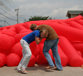 Kjell Hahn and Jimmy Kuehnle take a break from testing a new inflatable installation