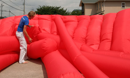Kjell Hahn helps untangle a large inflatable for a test inflate