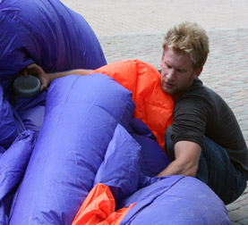 Jimmy Kuehnle inflating the inflatable suit titled Walking Fish in San Antonio, Texas